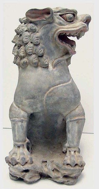 One of a Pair of Seated Lions