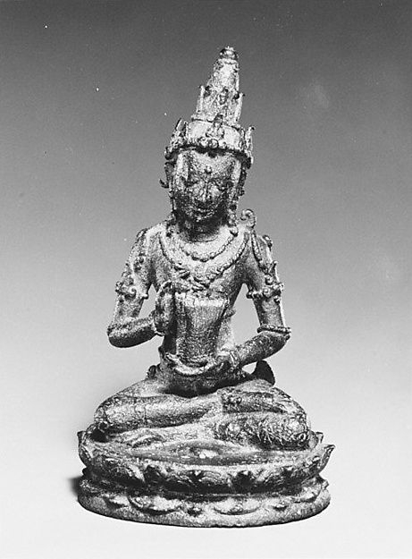 Seated Male Deity Holding a Cuirass (Chest Armour)