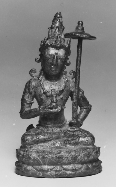 Seated Male Deity Holding a Parasol and an Unidentified Object