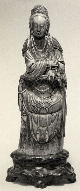 Seated Figure of Guanyin on Rock Base with Carved Armrest