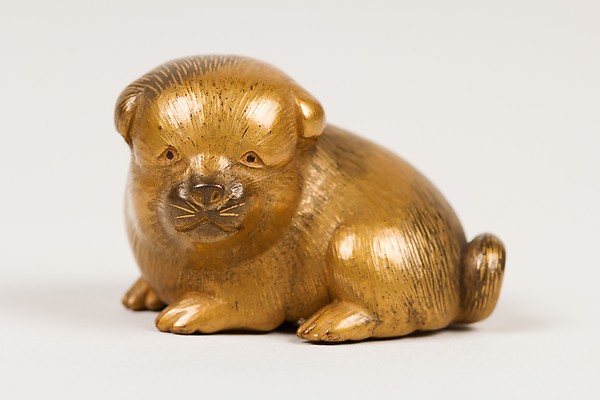 Netsuke of Seated Puppy with Short Curled Tail