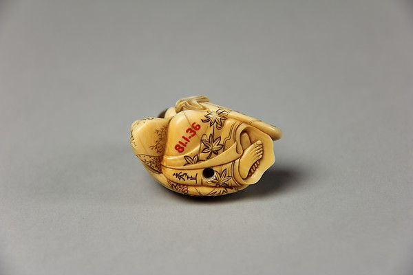 Netsuke of Seated Figure of Usume Laughing
