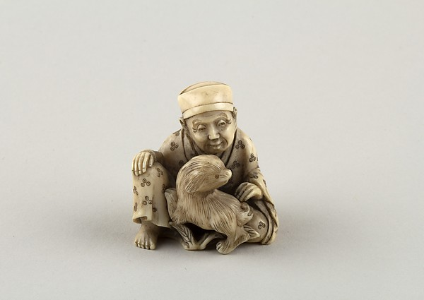 Netsuke of Seated figure of a Man with Dog