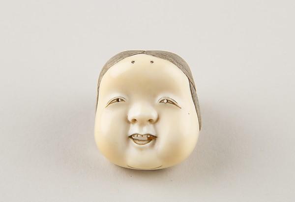 Netsuke of Kyōgen Mask; Usume (or Okama or Ofuku)