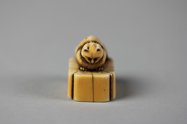 Netsuke of Cat on a Seal-Shaped Base