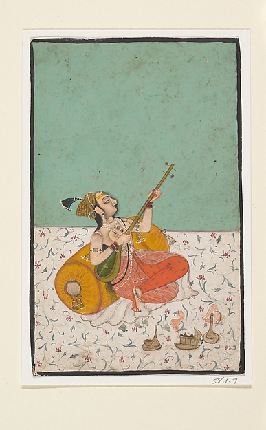 Lady Musician Playing a Sitar