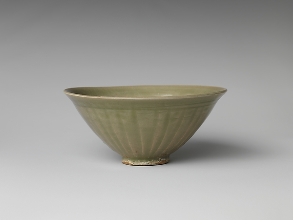 Bowl with Decoration of Boys in Waves