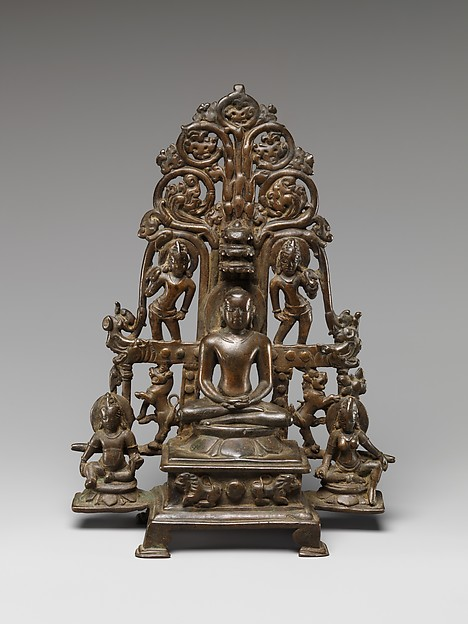 Enthroned Jina Attended by a Yaksha, a Yakshi, and Chauri-Bearers