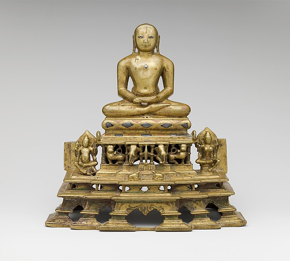 Svetambara Enthroned Jina, with Attendant Yaksha and Yakshi