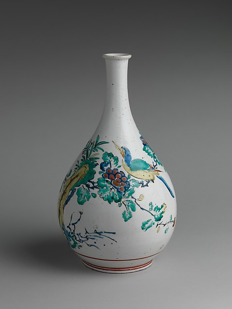 Bottle with Rock, Flowers, and Birds