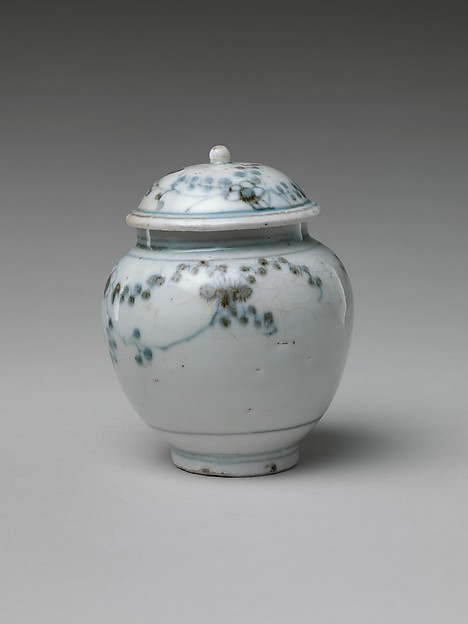 Jar and Lid with Flowering Plant