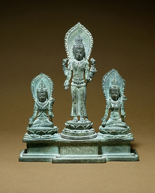 Standing Four-Armed Avalokiteshvara Flanked by Tara and Bhrikuti(?)