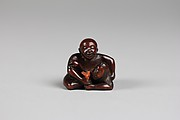 Netsuke of a Man Holding a Mermaid