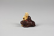 Netsuke of Old Man with a Tiger
