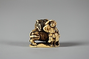 Netsuke of Man Leading an Ox with Bundles of Wood on its Back