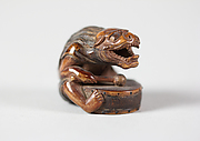 Netsuke of Masked Figure with a Drum