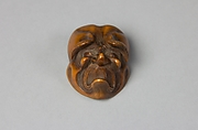 Netsuke: Mask of Unhappy Old Man
