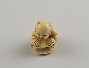 Netsuke of Child with a Shell