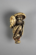 Netsuke of a Man Wearing a Large Hat, Carrying a Demon on His Back