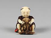 Netsuke of Boy Playing with a Dog