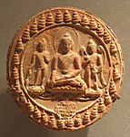 Votive Plaque with Seated Buddha and Attendants