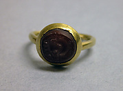 Ring with Inset Circular Red Stone