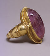 Ring with Large Purple Oval-Shaped Stone in Plain Mount