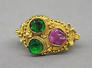 Ring with Bezel of Three Stones and Foliate Designs