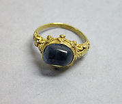 Ring with Blue Stone and Filigree Designs on Mount