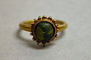 Ring with Green Stone in Circular Mount