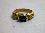 Ring with Red Stone set in Unadorned Bezel