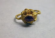 Ring with Purplse Stone set in Lotus Mount