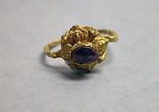 Ring with Purplse Stone set in Lotus Mount