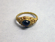 Stirrup-shaped Ring with Purple Stone