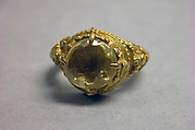 Ring with Yellow Stone and Ornamented with Foliate Forms