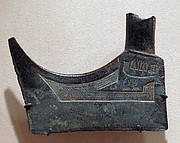 "Large Pediform Ax with Animals, Boat and ""Feather Man"""