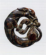 Harness Ornament in the Shape of a Coiled Wolf