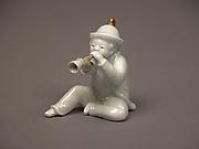 Boy Blowing a Horn