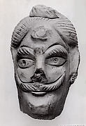Fragment of a Mask of a Man's Head