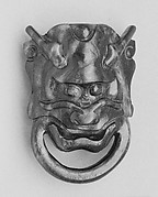 Mask of a Demon Holding a Ring