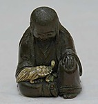Netsuke: probably Illustrating Legend of Urashima Taro.