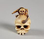 Netsuke of Skeleton Astride a Skull