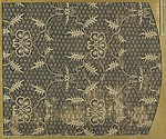 Textile fragment with repeating floral pattern on geometric diaper ground