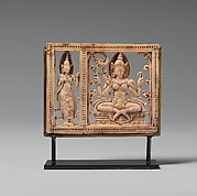 Plaque with Seated Dhanada-Tara and Attendant