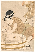 Woman Washing Baby in Tub