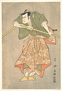 The Actor Kataoka Nizaemon in Ceremonial Robes of Green and Pink, Drawing His Sword