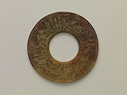 Annular Disk with Carved Designs