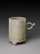 Cup with ring handle and archaic designs