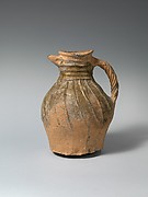 Jug with twisted handle