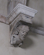 Corbel with Bearded Figure with Pinecone-Like Objects